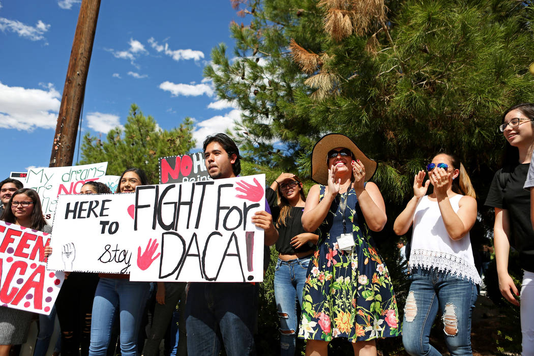 Individuals join in with high school students that organized a rally in support of the DREAM Act, at Rancho high school in Las Vegas, Wednesday, Sept. 13, 207. Elizabeth Brumley Las Vegas Review-J ...