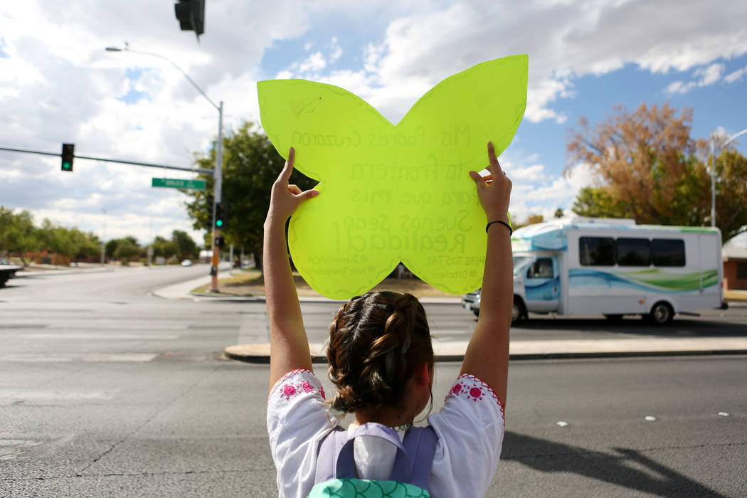 High school student Jennifer Avalos, 17, holds a sign in support of her family and friends affected by DACA during a rally in support of the DREAM Act at Rancho high school in Las Vegas, Wednesday ...