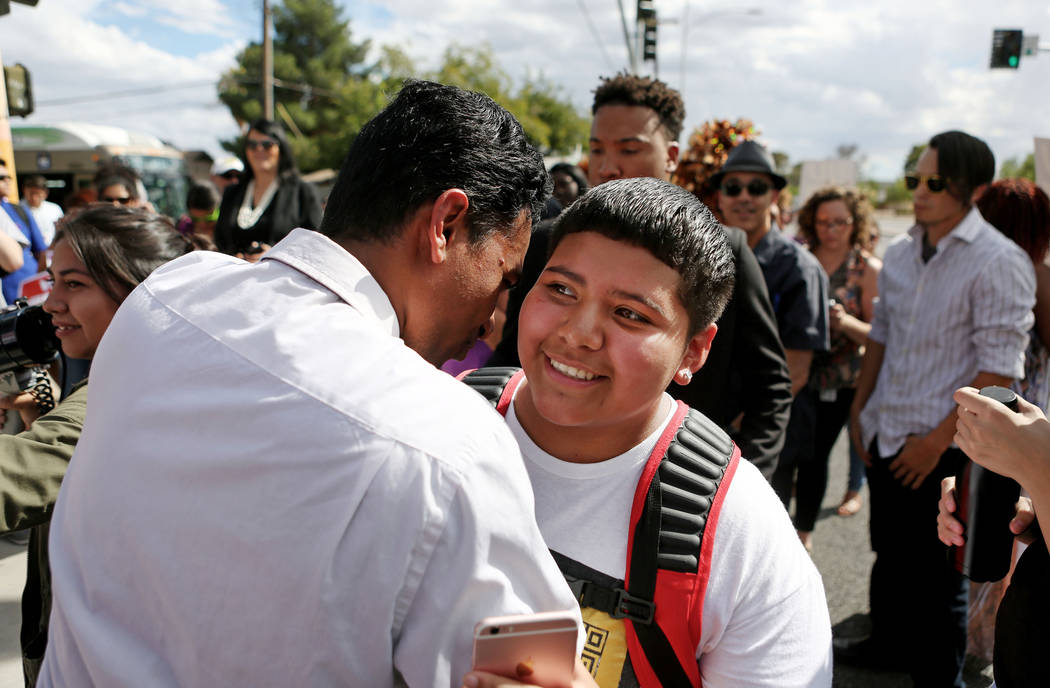 Rancho high school world history teacher and Democratic Congressional candidate Reuben D'Silva, left, encourages high school student Rachel Diaz, 16, after they spoke at a rally in support of the  ...