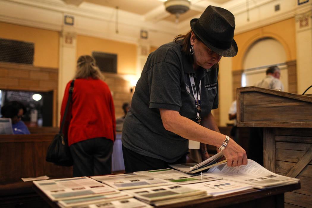Mob Museum Volunteer Renee Arciszewski grabs information sheets after an emergency preparedness safety forum at the Mob Museum in Las Vegas, Sunday, Sept. 17, 2017. Joel Angel Juarez Las Vegas Rev ...
