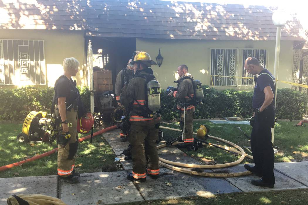 Two Clark County firefighters were hospitalized after battling a blaze at a single-story townhouse at Desert Inn and Sandhill roads in east Las Vegas, Tuesday afternoon, Sept. 12, 2017. (Bizuayehu ...