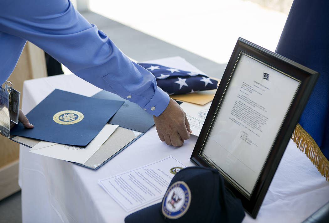 Letters and certificates for World War II Navy veteran William Darwin are set on a table during his 100th birthday celebration at the VA Medical Center on Tuesday, Sept. 12, 2017. Bridget Bennett  ...