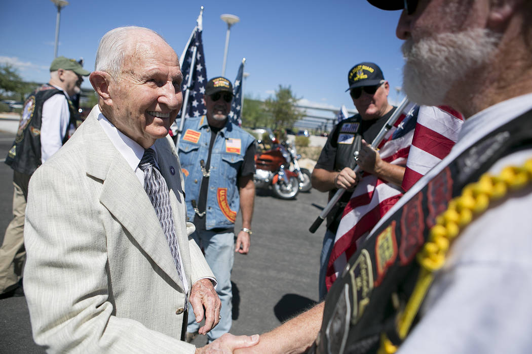 World War II Navy veteran William Darwin, left, thanks other veterans for coming to his 100th birthday celebration at the VA Medical Center on Tuesday, Sept. 12, 2017. Bridget Bennett Las Vegas Re ...
