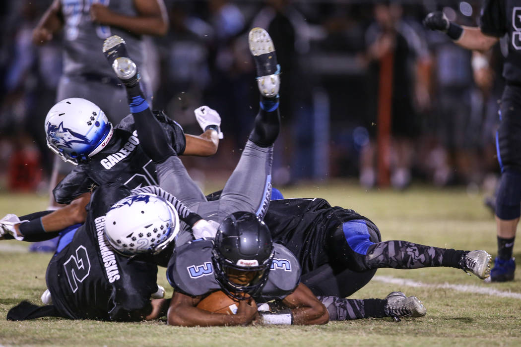 Canyon Springs' Jayvion Pugh (3) is tackled by Basic during the second quarter of a football game at Basic High School in Henderson, Friday, Sept. 15, 2017. Joel Angel Juarez Las Vegas Review-Jour ...
