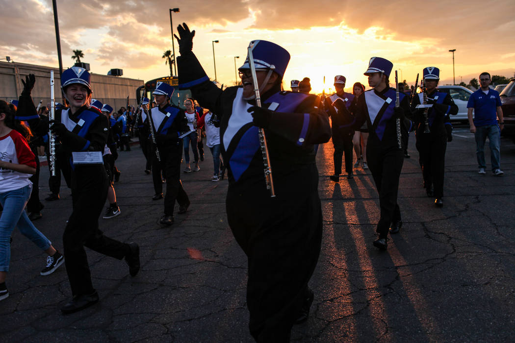 Miya Morales of Basic Academy's Band marches toward the stadium before the start of a football game against Canyon Springs at Basic High School in Henderson, Friday, Sept. 15, 2017. Joel Angel Jua ...