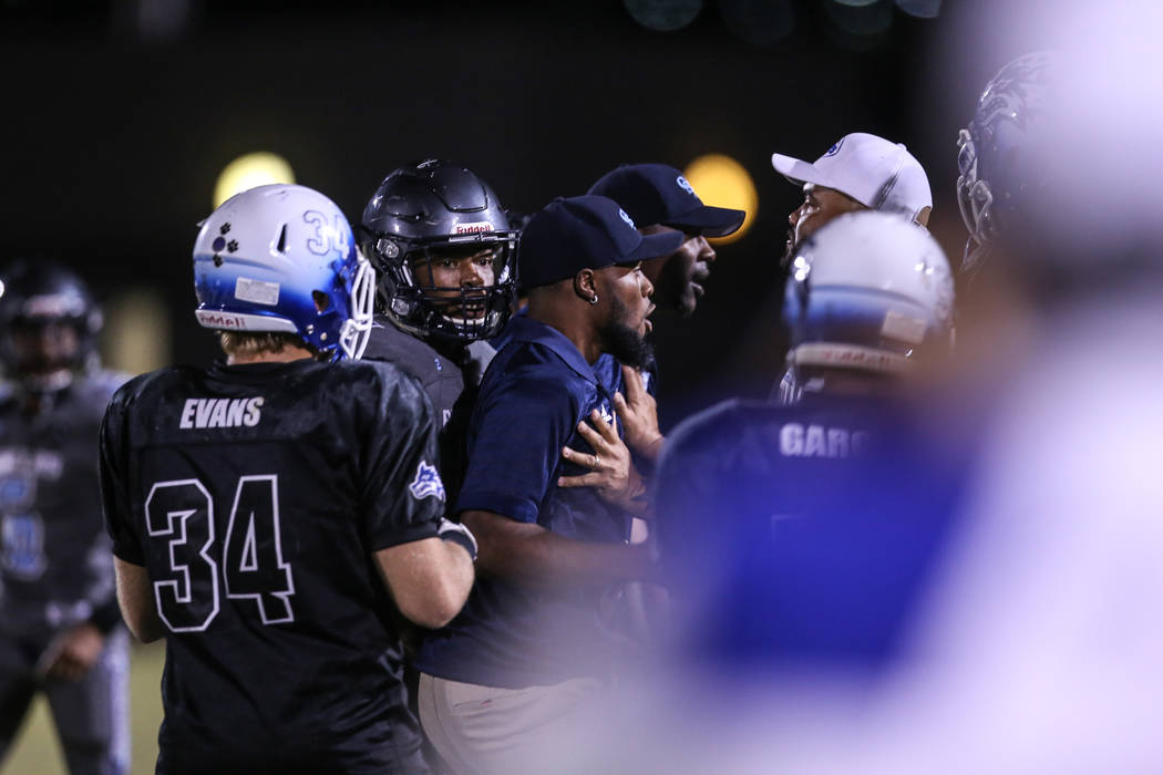 Canyon Springs coaches confront Basic at the end of a football game at Basic High School in Henderson, Friday, Sept. 15, 2017. Canyon Springs won 15-20. Joel Angel Juarez Las Vegas Review-Journal  ...