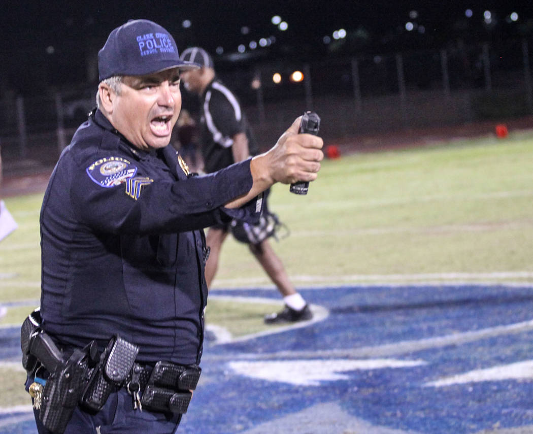 A police officer holds pepper spray after dispersing a brawl between Canyon Springs and Basic football teams at the end of a game at Basic High School in Henderson, Friday, Sept. 15, 2017. Canyon  ...