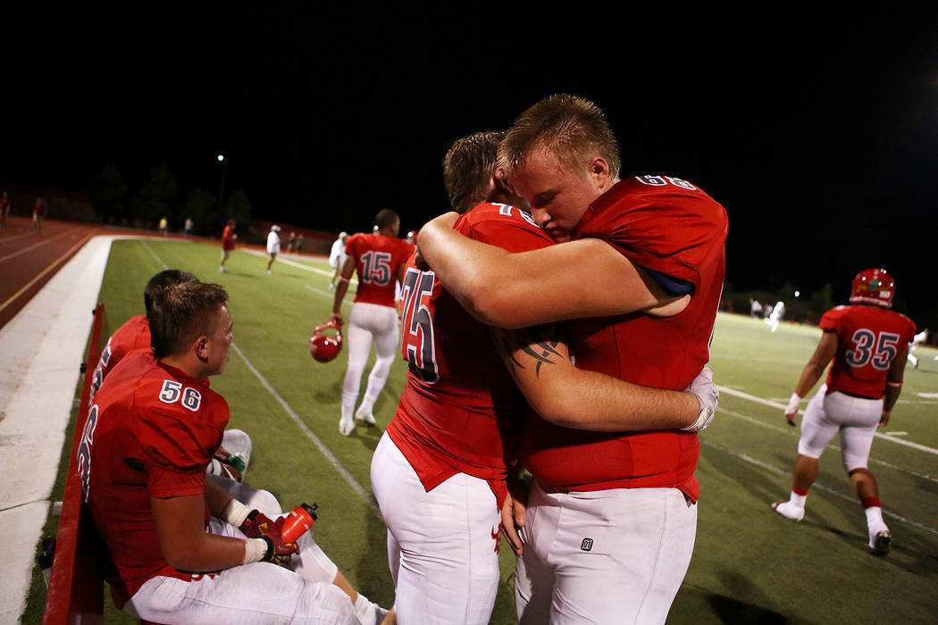 Arbor View players Matthew Smith (75) and Roderic Newton (68) embrace after a touchdown over Faith Lutheran during the second half of the game at Arbor View High School on Friday, Sept. 15, 2017,  ...