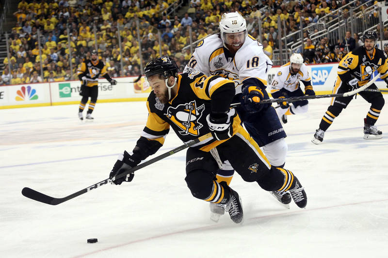 Nashville Predators left wing James Neal (18) hits Pittsburgh Penguins right wing Bryan Rust (17) during the third period in game five of the 2017 Stanley Cup Final at PPG PAINTS Arena. (Charles L ...
