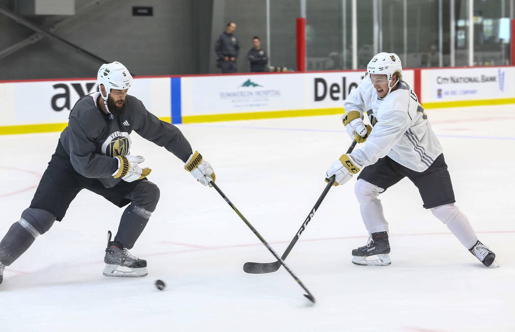 Vegas Golden Knights Deryk Engelland, left, pressures teammate Brendan Leipsic in a scrimmage game during practice at the City National Arena on Friday, Sept. 15, 2017, in Las Vegas. Richard Brian ...