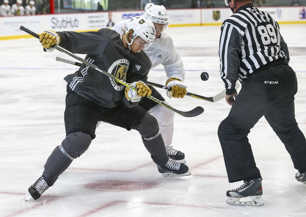 Vegas Golden Knights' William Karlsson, left, and Vadim Shipachyov face off in a scrimmage game during team practice at the City National Arena on Friday, Sept. 15, 2017, in Las Vegas. Richard Bri ...