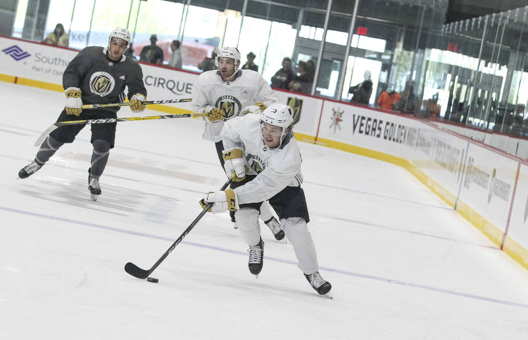 Vegas Golden Knights' Brendan Leipsic, foreground, drives the puck in a scrimmage game during team practice at the City National Arena on Friday, Sept. 15, 2017, in Las Vegas. Richard Brian Las Ve ...