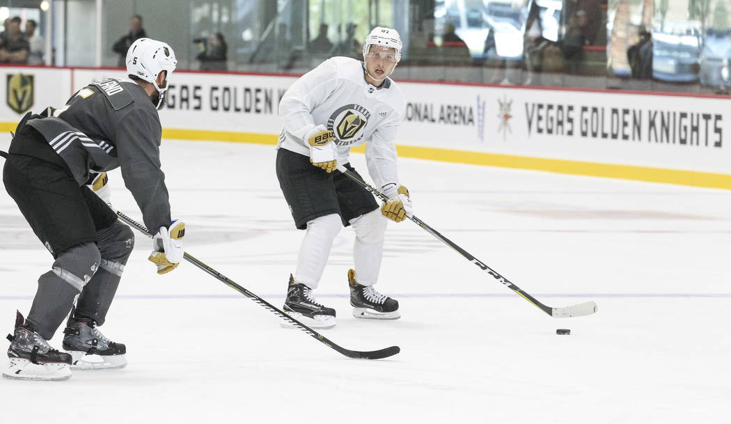 Vegas Golden Knights' Vadim Shipachyov, right, looks for a pass through Deryk Engelland in a scrimmage game during team practice at the City National Arena on Friday, Sept. 15, 2017, in Las Vegas. ...