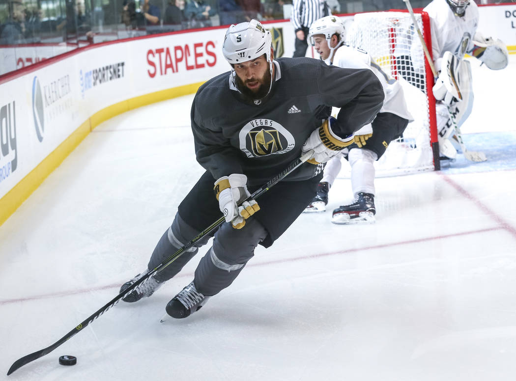 Vegas Golden Knights defenseman Deryk Engelland gets control of the puck in a scrimmage game during team practice at the City National Arena on Friday, Sept. 15, 2017, in Las Vegas. Richard Brian  ...