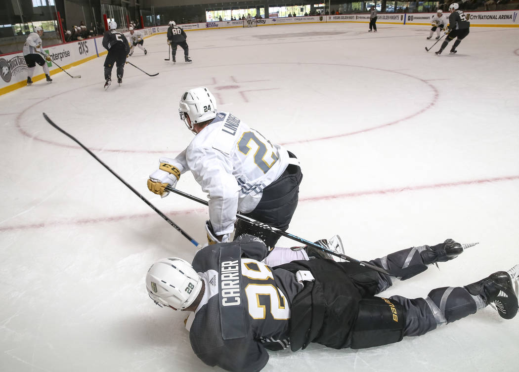 Vegas Golden Knights' Oscar Lindberg, top, and William Carrier (28) get back up after tripping in scrimmage game during team practice at the City National Arena on Friday, Sept. 15, 2017, in Las V ...