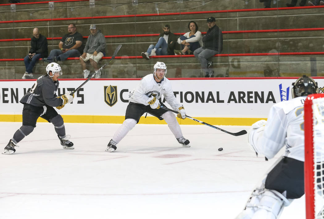 Vegas Golden Knights' Oscar Lindberg, center, and Tyler Wong, left, take part in a scrimmage game during team practice at the City National Arena on Friday, Sept. 15, 2017, in Las Vegas. Richard B ...