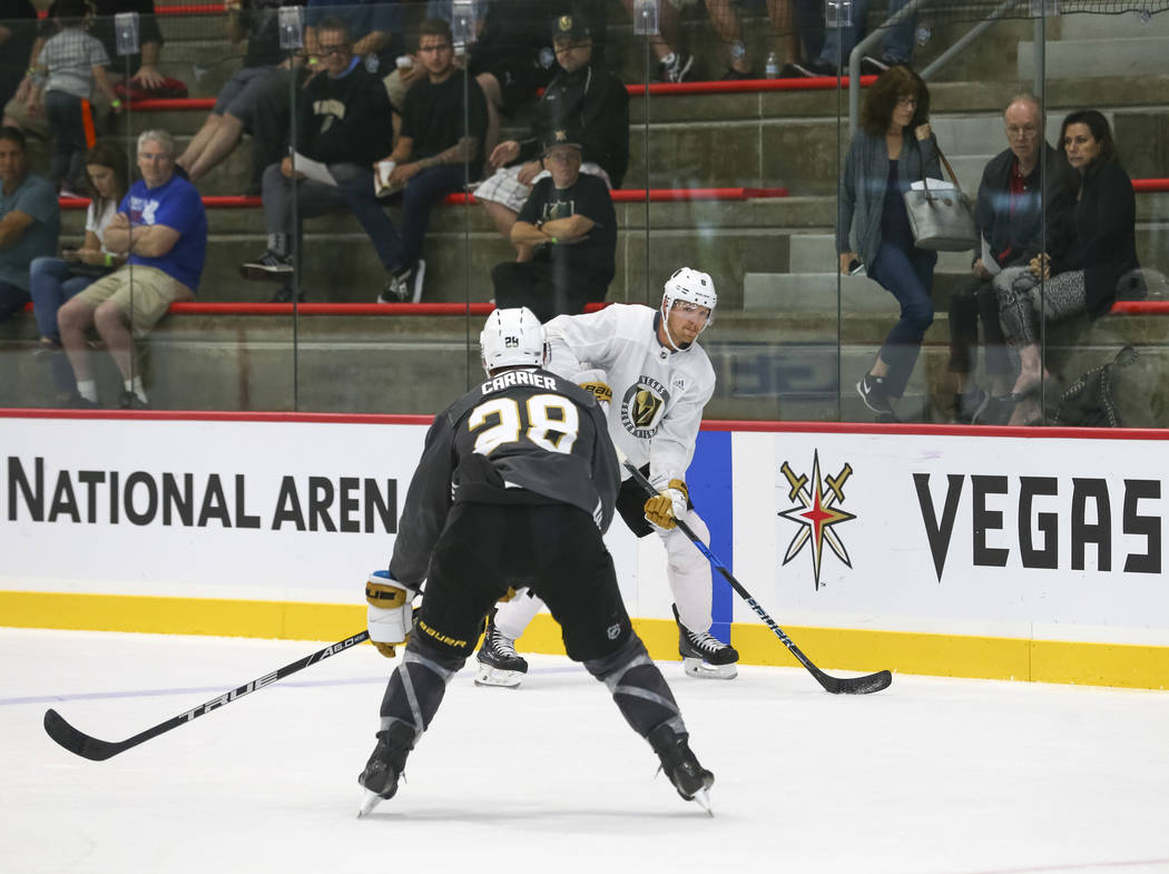 Vegas Golden Knights' Griffin Reinhart, right, looks for a pass through Golden Knights William Carrier in a scrimmage game during team practice at the City National Arena on Friday, Sept. 15, 2017 ...