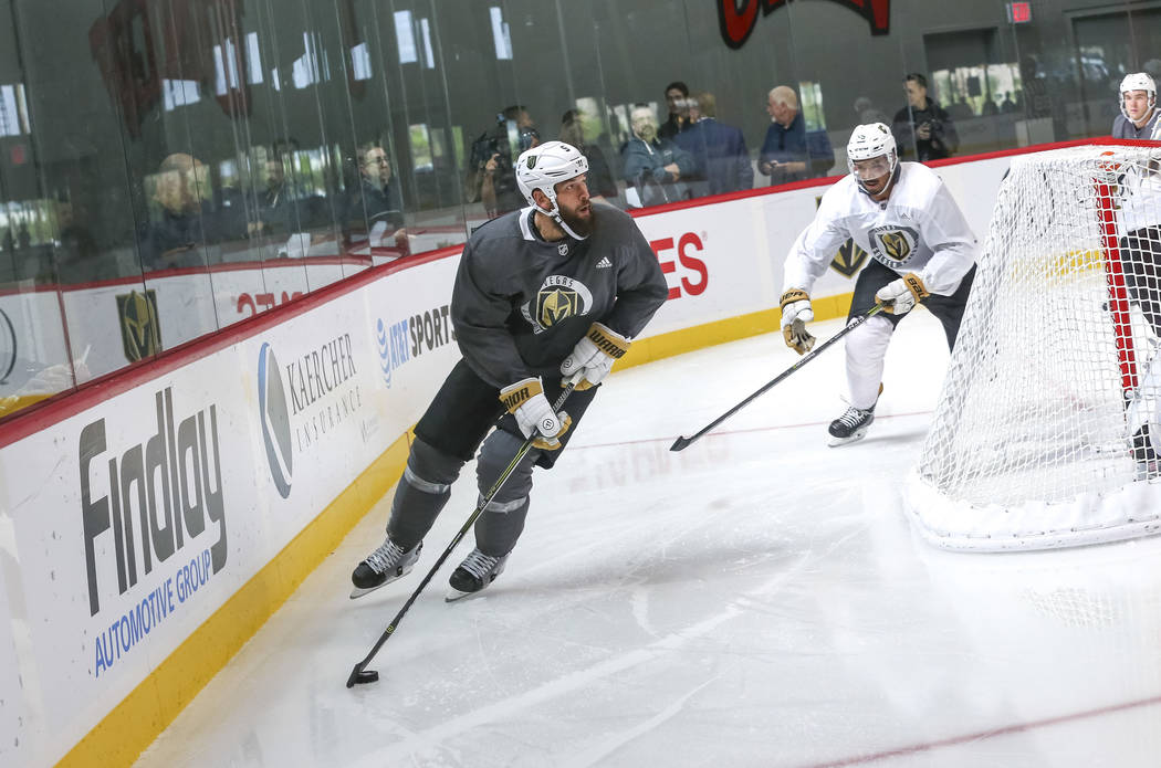 Vegas Golden Knights' Deryk Engelland, left, controls the puck in a scrimmage game during team practice at the City National Arena on Friday, Sept. 15, 2017, in Las Vegas. Richard Brian Las Vegas  ...