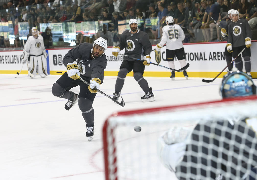 Vegas Golden Knights left wing Pierre-Edouard Bellemare (41) shoots a goaltender Dylan Ferguson (1) in a drill during the NHL team's practice at the City National Arena in Las Vegas, Saturday, Sep ...