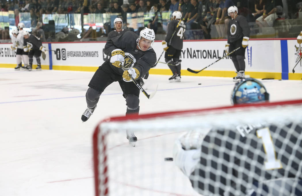 Vegas Golden Knights forward Stephen MacAulay (93) shoots a goaltender Dylan Ferguson (1) in a drill during the NHL team's practice at the City National Arena in Las Vegas, Saturday, Sept. 16, 201 ...