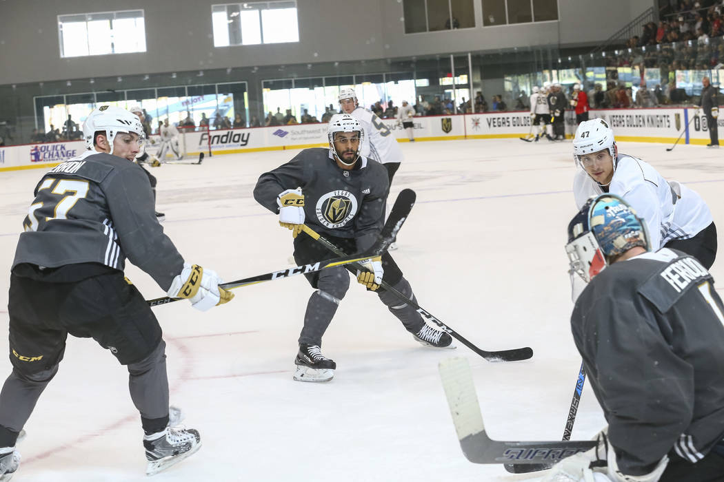 Vegas Golden Knights' David Perron, from left, Pierre-Edouard Bellemare, Luca Sbisa and Dylan Ferguson take part in a drill during the NHL team's practice at the City National Arena in Las Vegas,  ...
