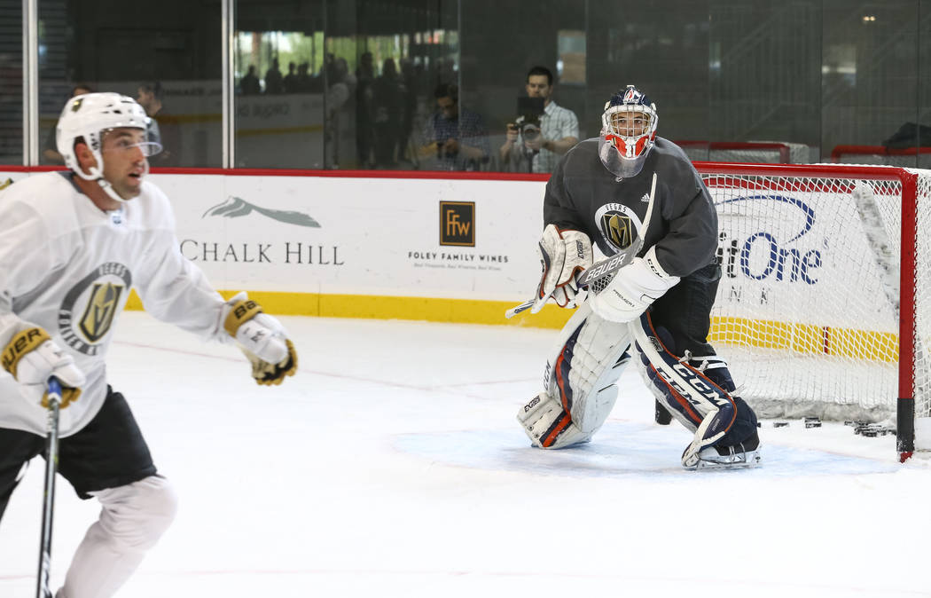 Vegas Golden Knights goaltender Dylan Ferguson, right, (1) protects his net in a scrimmage game during the NHL team's practice at the City National Arena in Las Vegas, Saturday, Sept. 16, 2017. Ri ...