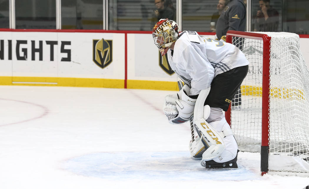 Vegas Golden Knights goaltender Maxime Lagace (33) protects his net in a scrimmage game during the NHL team's practice at the City National Arena in Las Vegas, Saturday, Sept. 16, 2017. Richard Br ...