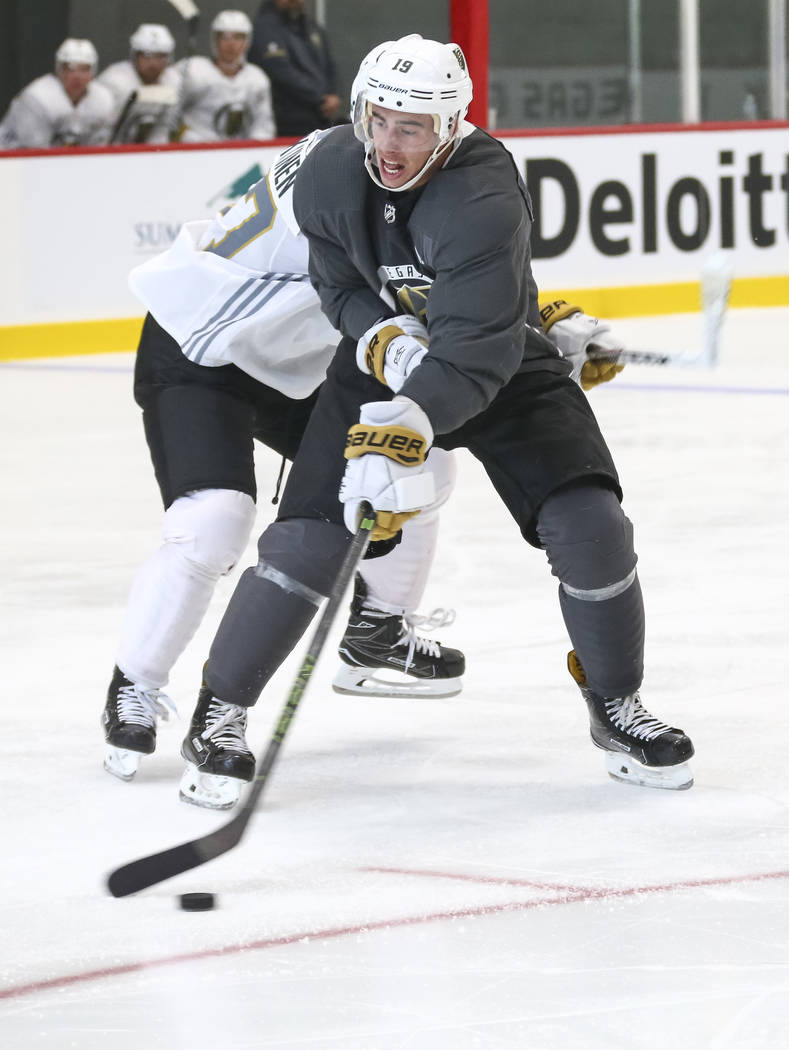 Vegas Golden Knights right wing Reilly Smith (19) attempt to control the puck in a scrimmage game during the NHL team's practice at the City National Arena in Las Vegas, Saturday, Sept. 16, 2017.  ...