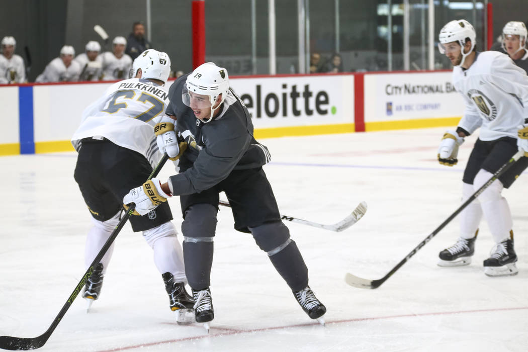 Vegas Golden Knights right wing Reilly Smith, center, (19) shoots past Golden Knights left wing Temmu Pulkkinen (67) in a scrimmage game during the NHL team's practice at the City National Arena i ...