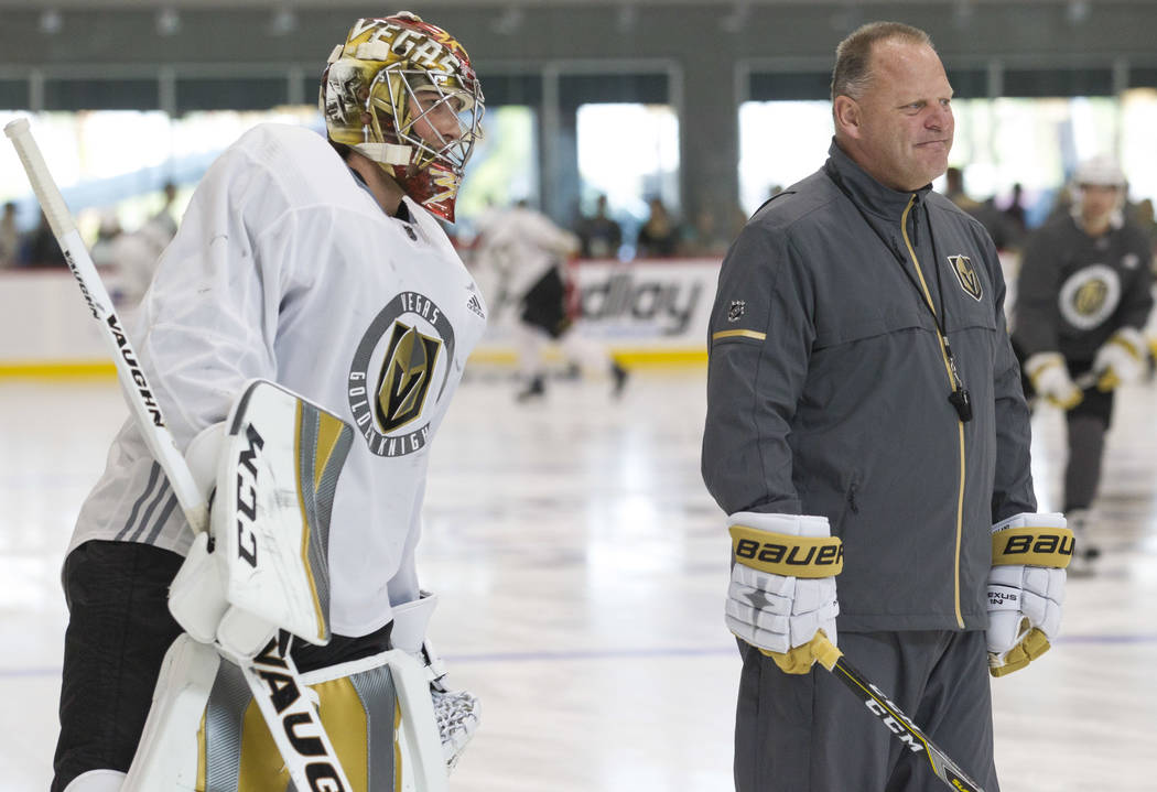 Vegas Golden Knights goaltender Maxime Lagace, left, (33) and Golden Knights head coach Gerard Gallant skate a lap during the NHL team's practice at the City National Arena in Las Vegas, Saturday, ...