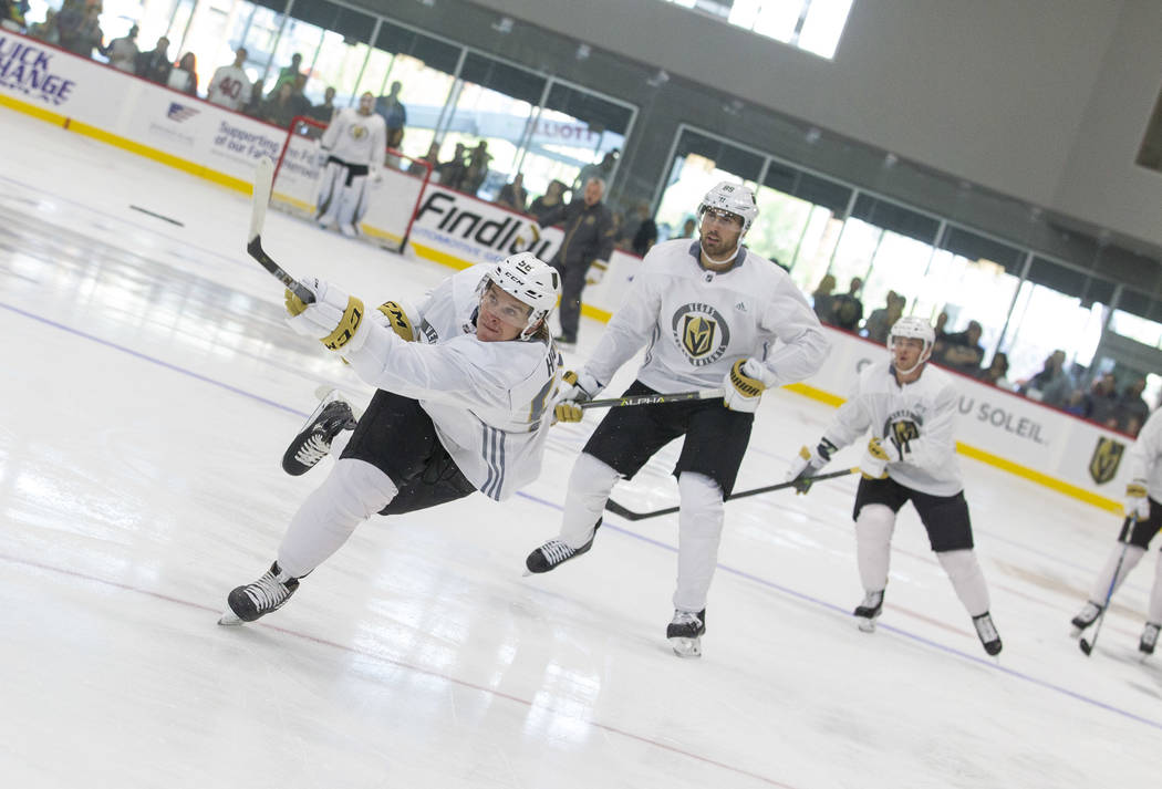 Vegas Golden Knights left wing Erik Haula, left, (56) takes a slapshot in a scrimmage game during the NHL team's practice at the City National Arena in Las Vegas, Saturday, Sept. 16, 2017. Richard ...