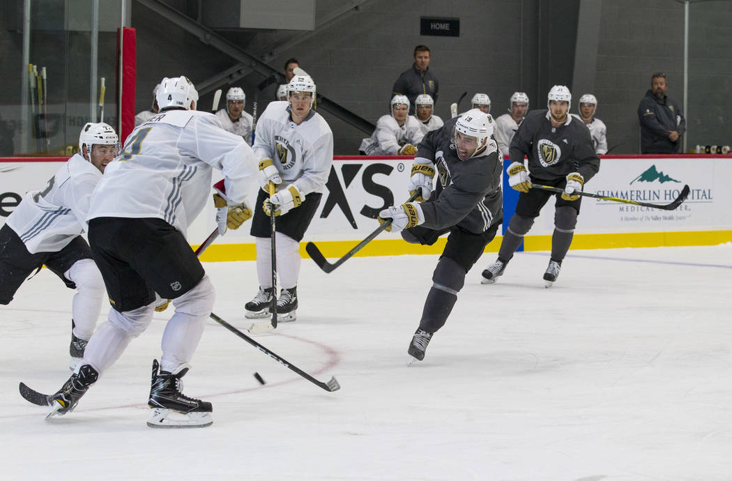 Vegas Golden Knights right wing Reilly Smith (19) takes a slapshot in a scrimmage game during the NHL team's practice at the City National Arena in Las Vegas, Saturday, Sept. 16, 2017. Richard Bri ...