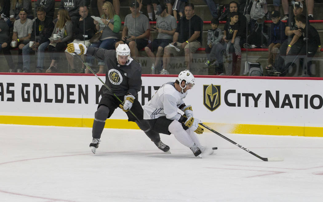Vegas Golden Knights right wing Reilly Smith, left, (19) and Golden Knights right defenseman Colin Miller (6) vie for the puck in a scrimmage game during the NHL team's practice at the City Nation ...