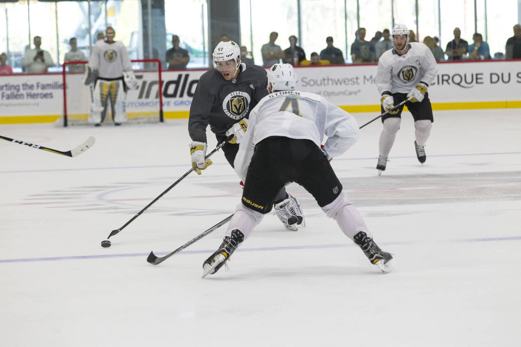 Vegas Golden Knights left wing David Perron (57) carries the puck towards Golden Knights left defenseman Clayton Stoner (4) in a scrimmage game during the NHL team's practice at the City National  ...
