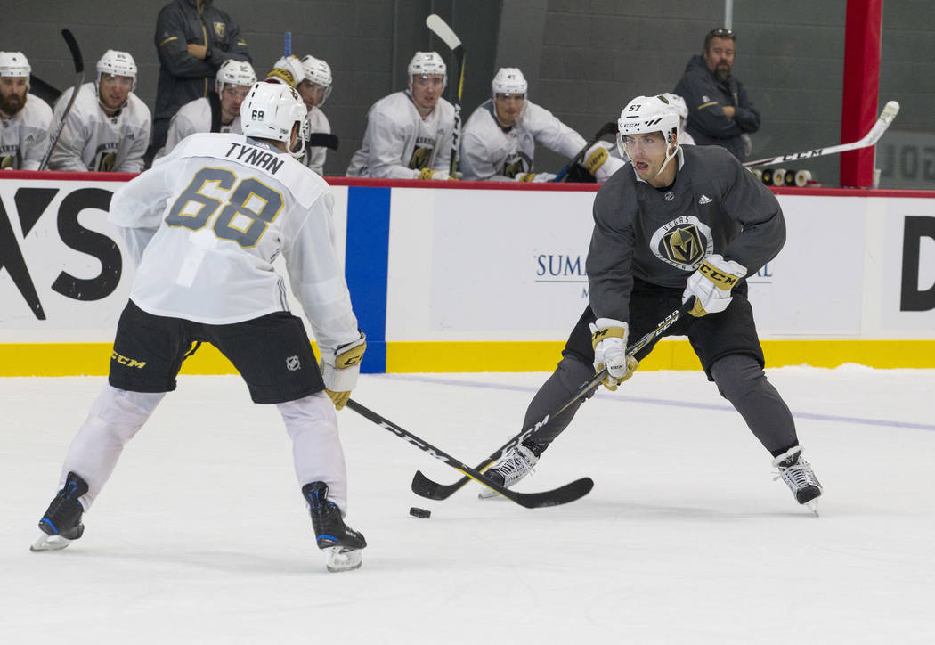 Vegas Golden Knights centerman TJ Tynan (68) puts pressure on Golden Knights left wing David Perron (57) in a scrimmage game during the NHL team's practice at the City National Arena in Las Vegas, ...