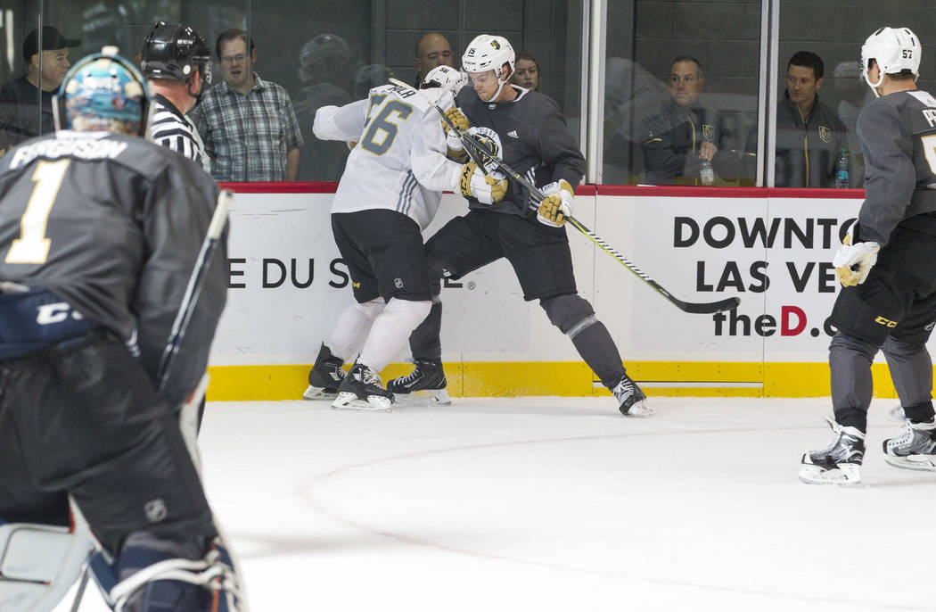 Vegas Golden Knights left wing Erik Haula, second left, (56) and Golden Knights left defenseman Jon Merrill, second right, (15) vie for the puck in a scrimmage game during the NHL team's practice  ...