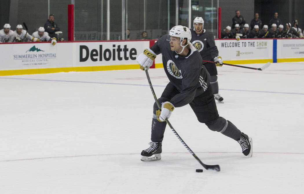 Vegas Golden Knights left defenseman Jon Merrill (15) takes a shot in a scrimmage game during the NHL team's practice at the City National Arena in Las Vegas, Saturday, Sept. 16, 2017. Richard Bri ...
