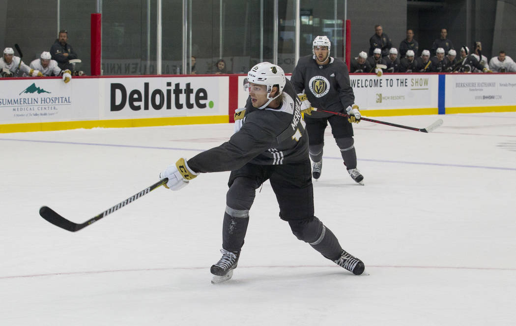 Vegas Golden Knights left defenseman Jon Merrill (15) takes a shot during a scrimmage game during the NHL team's practice at the City National Arena in Las Vegas, Saturday, Sept. 16, 2017. Richard ...