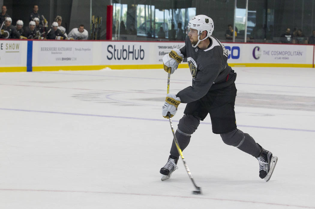 Vegas Golden Knights left defenseman Shea Theodore (27) takes a shot during a scrimmage game during the NHL team's practice at the City National Arena in Las Vegas, Saturday, Sept. 16, 2017. Richa ...