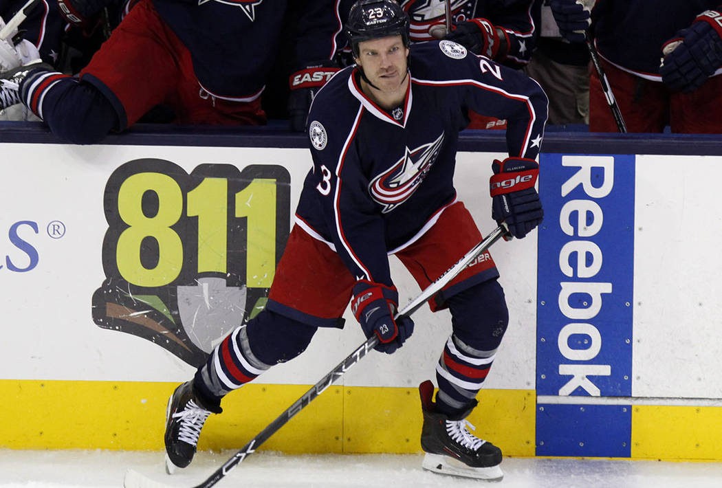 Columbus Blue Jackets' David Clarkson carries the puck against the Pittsburgh Penguins during an NHL hockey game in Columbus, Ohio Friday, March 11, 2016. Pittsburgh won 3-2. (AP Photo/Paul Vernon)