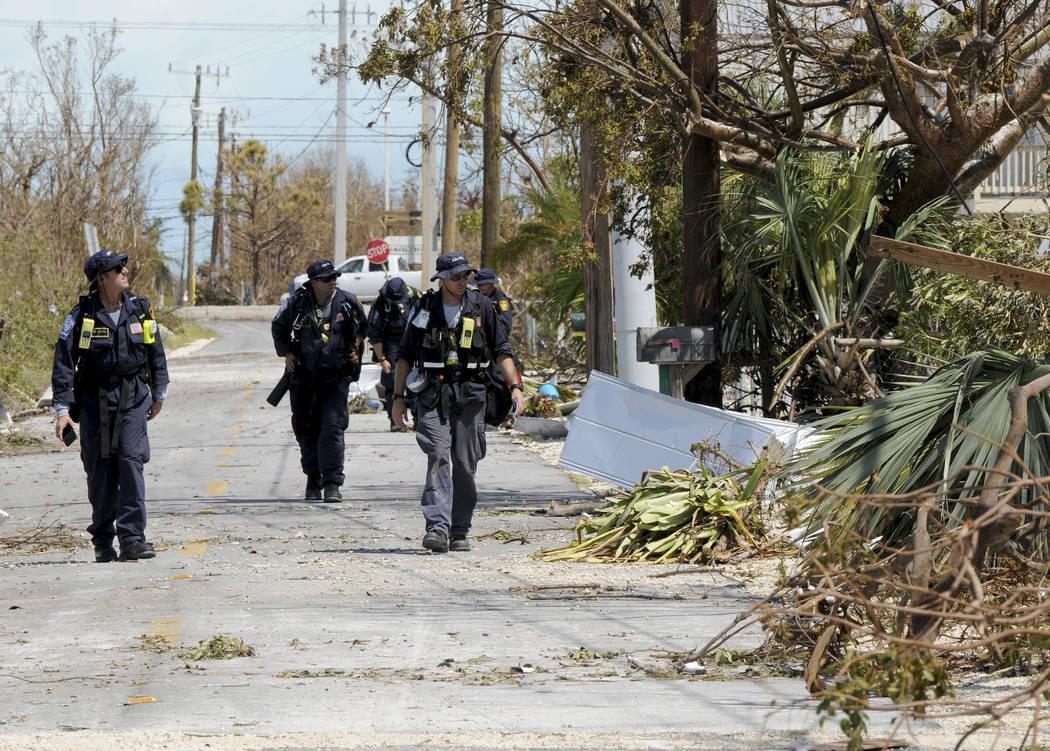 Los Angeles City Fire Department FEMA California Task Force 1 go house-to-house Tuesday, Sept. 12, 2017, looking for residents in a community on Cudjoe Key, Fla. where Hurricane Irma's eye made la ...