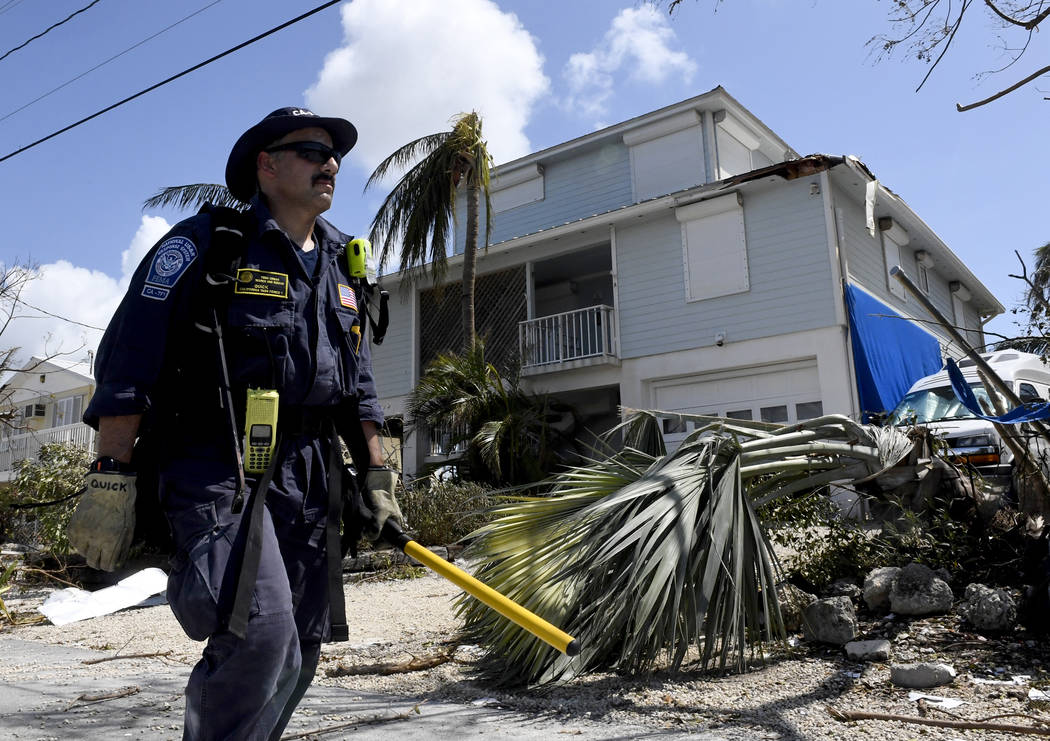 Los Angeles City Fire Department FEMA California Task Force 1 go house-to-house looking for residents in a community in Cudjoe Key, Fla. Tuesday, Sept. 12, 2017, where Hurricane Irma's eye made la ...