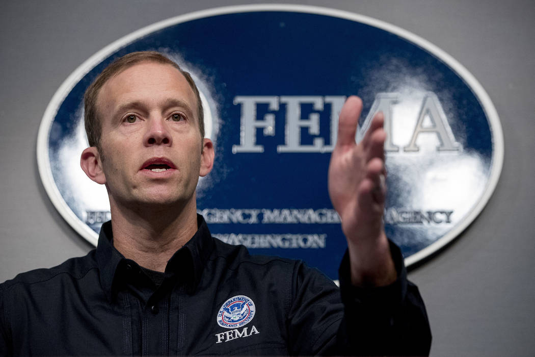 Federal Emergency Management Agency Administrator Brock Long speaks at FEMA headquarters in Washington, Tuesday, Sept. 12, 2017, to give an update on federal government support in the aftermath of ...