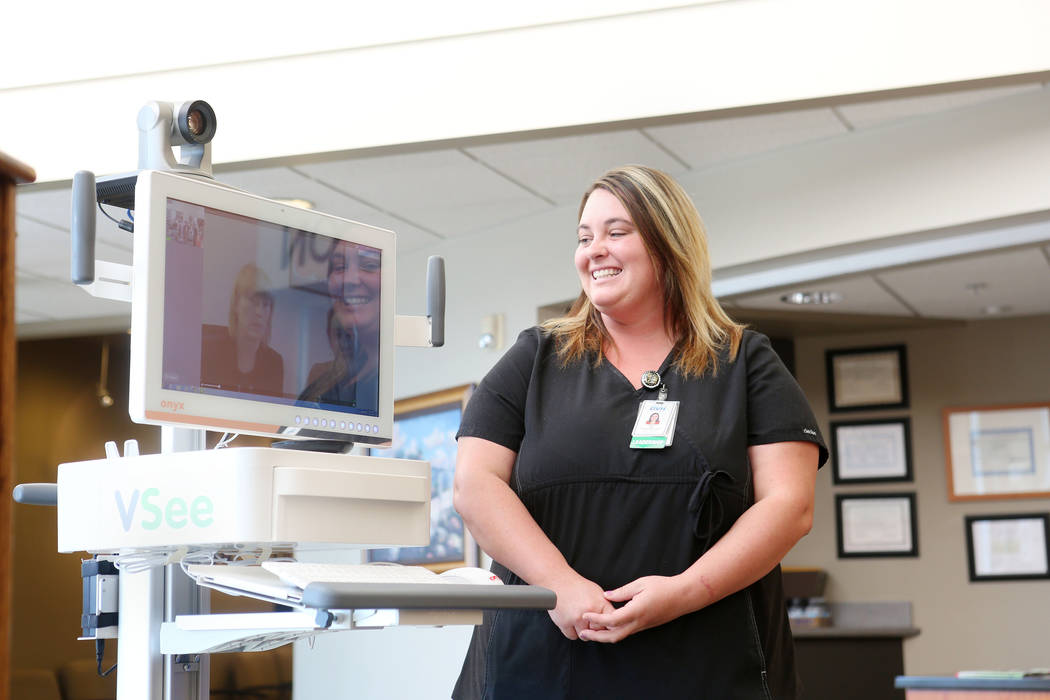 ER manager Case Lamp speaks with staff from Carson City Rural Clinics while demonstrating the new Telehealth technology during the Nevada Hospital Association's and the technology company Switch's ...