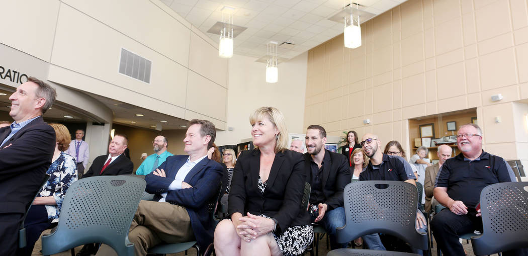 Individuals watch a demonstration of the new Telehealth technology during the Nevada Hospital Association's and the technology company Switch's announcement of the Nevada Broadband Telemedicine In ...