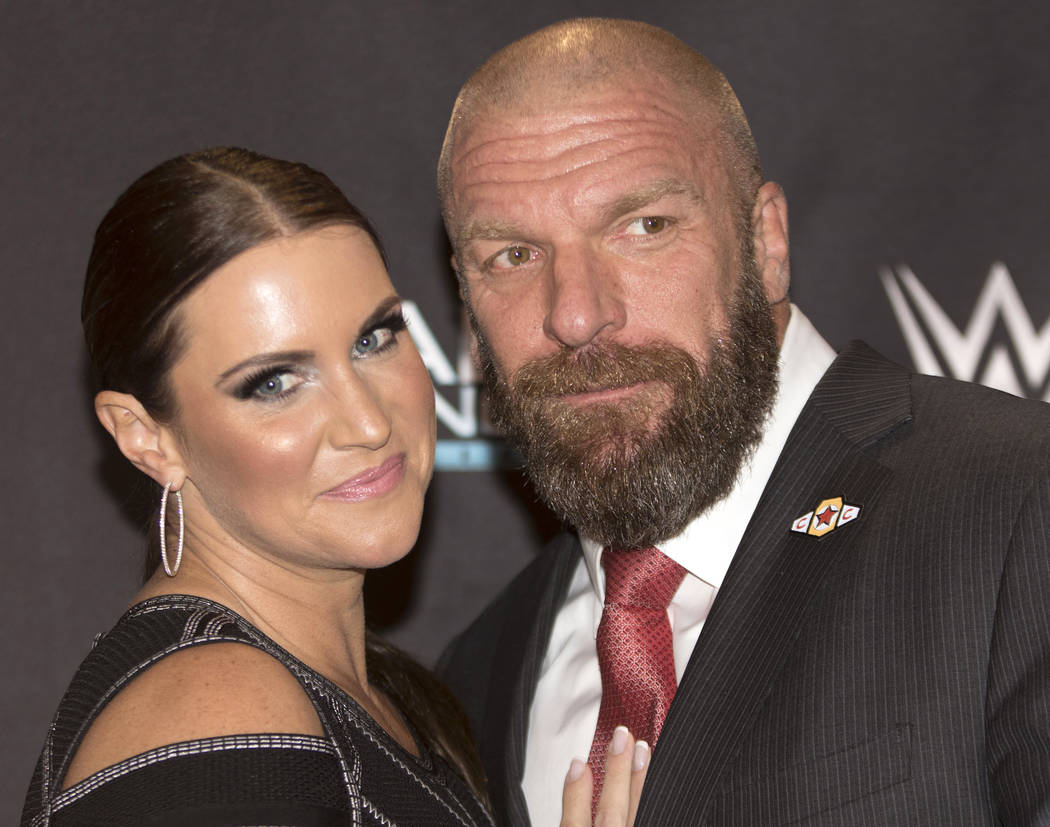 "WWE's Chief Brand Officer Stephanie McMahon, left, with her husband and Executive Vice President of the promotion Paul ""Triple H"" Levesque on the red carpet at the Mae Young Clas ..."