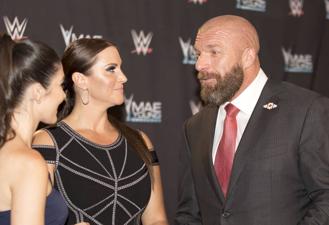"WWE Chief Brand Officer Stephanie McMahon, center, and her husband, Executive Vice President of Talent and Creative Paul ""Triple H"" Levesque, are interviewed on the Mae Young Cla ..."