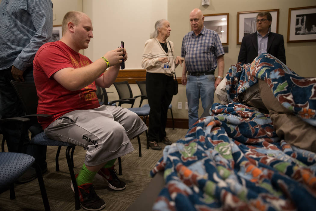 Las Vegas resident Nathan Claus takes a photo of the dummy used to catch Shane Schindler after a panel at the Mob Museum on Tuesday, Sep. 19, 2017, in Las Vegas. Morgan Lieberman Las Vegas Revie ...