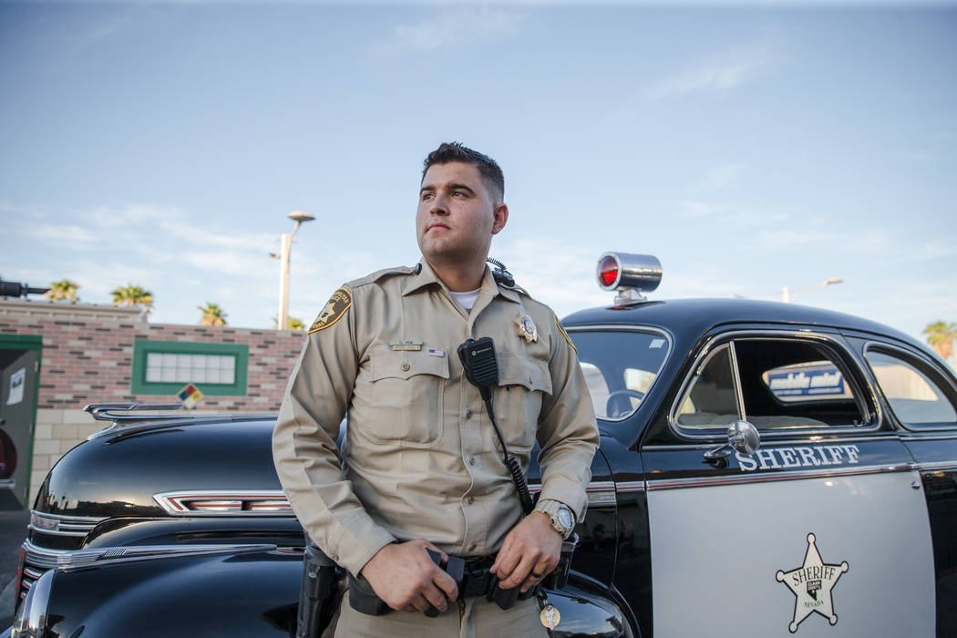 LVMPD Police Officer Cody Vigil stands in front of an old police car at the Mob Museum on Tuesday, Sep. 19, 2017, in Las Vegas. Morgan Lieberman Las Vegas Review-Journal