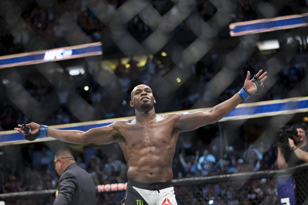 Jon Jones celebrates his win against Daniel Cormier in the light heavyweight title bout during UFC 214 at the Honda Center in Anaheim, Calif., on Saturday, July 29, 2017. Jones won by knockout. Er ...